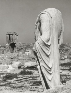 "GREECE. Peloponnese. Corinth. ""Torso of a robed statue and Temple of Apollo"" Photographer Herbert List, 1937 Source: magnumphotos.com"