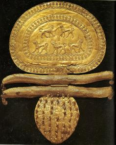 An Etruscan fibula that has been gilded and has tiny lion figures on the clasp.
